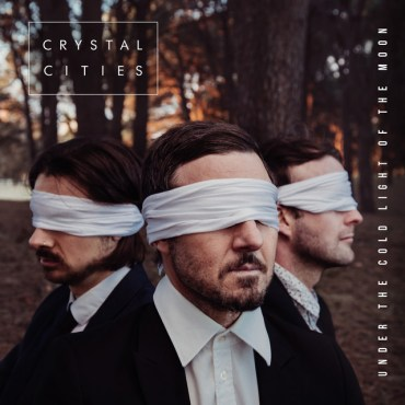 This album cover is three men standing in front of some trees with blindfolds on.