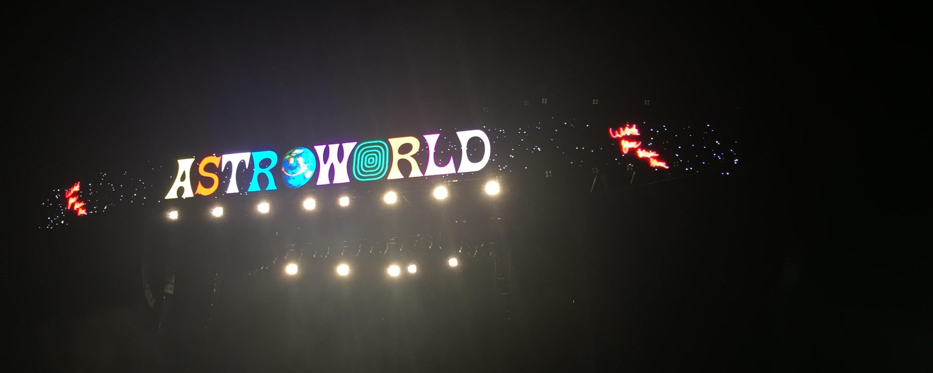 The picture features the Astroworld logo sign at Astroworld Festival.