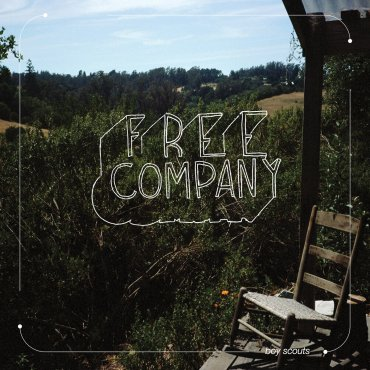 The album cover is a picture of a field with a chair in the corner with white text that reads free company.