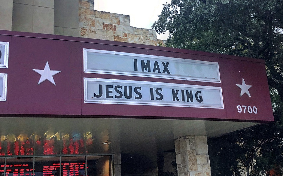 The sign outside an Austin movie theatre showing Jesus is King.