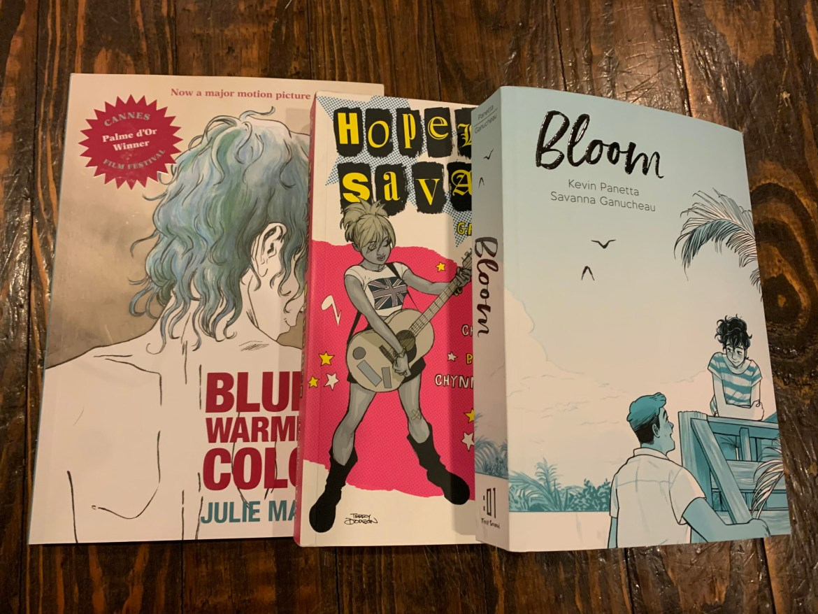 A picture of my copy of Hopeless Savages, Bloom and Blue Is the Warmest Color
