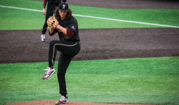 Freshman righ-handed pitcher Tony Robie is pitching for the Texas State Bobcats. He prepares to throw a pitch.