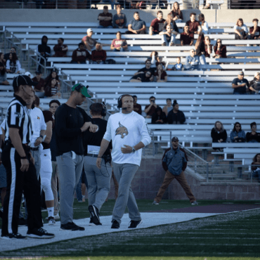 Jake Spavital communicating with offensive coordinator