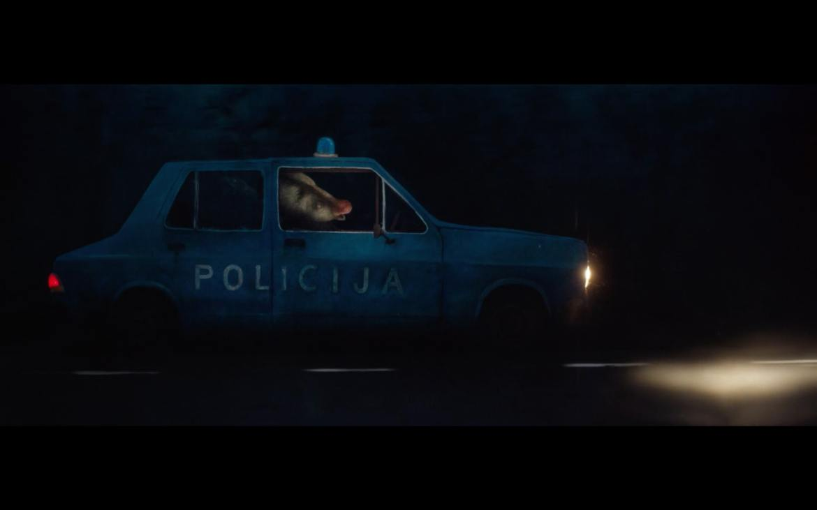 screenshot of a scene from Nighthawk with a badger driving a car