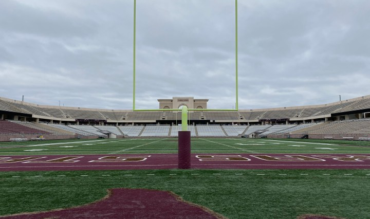 The field and the stands are empty at Jim Wacker Field on an overcast day. Shot taken from the south endzone.