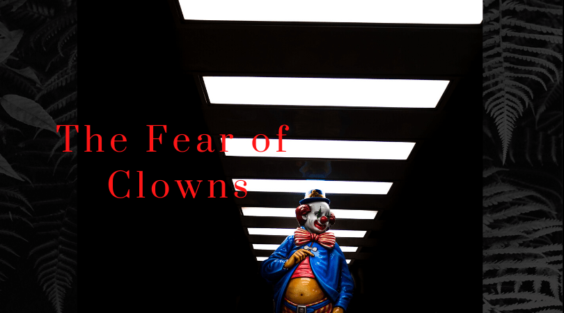 """An image of a cartoon clown with the text """"the fear of clowns."""" The clown is walking down a dark hallway lit with overhead lights."""