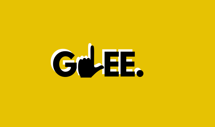 Glee written out on a yellow background with a hang making the letter L in Glee