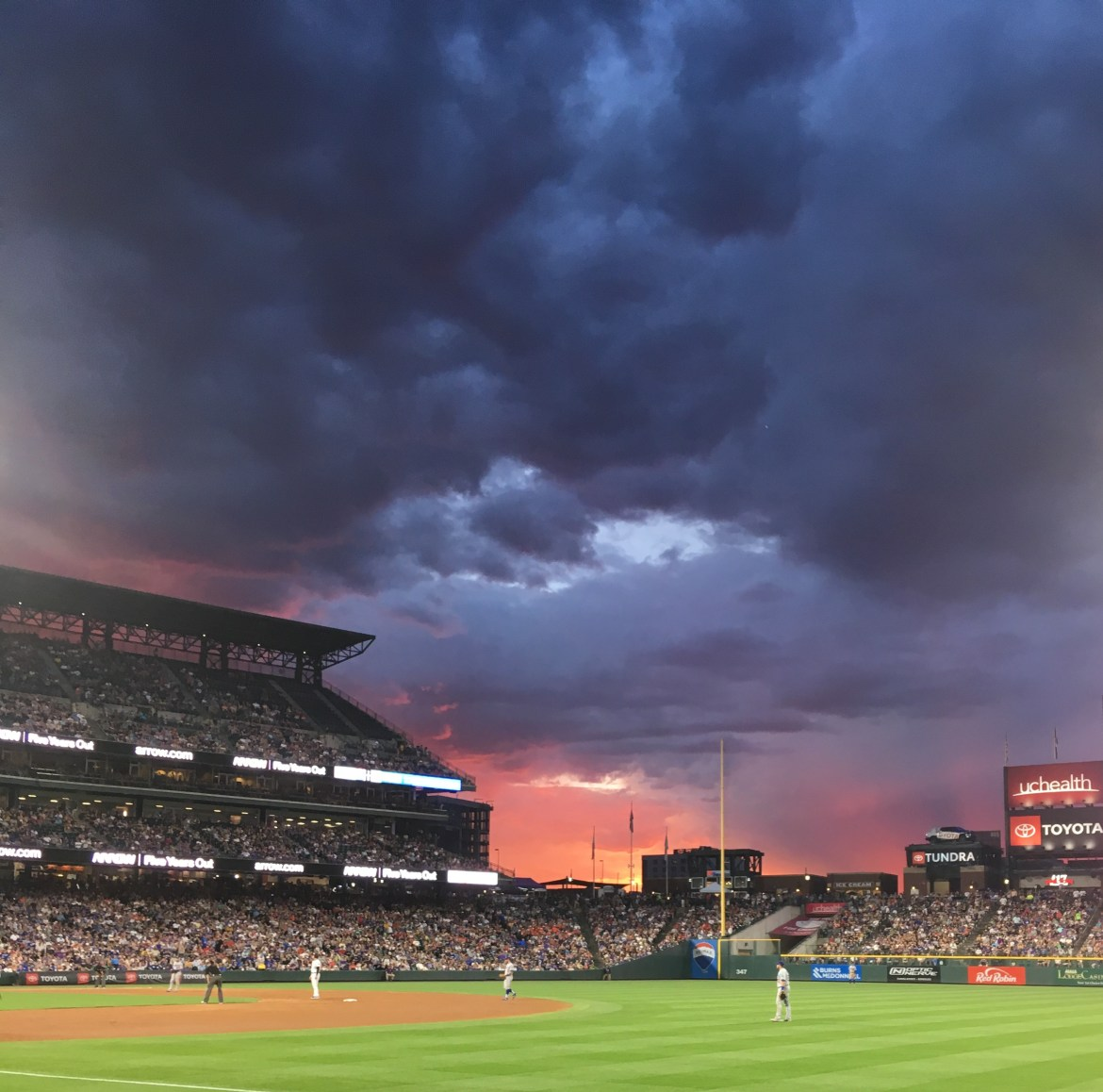 Coors Field Home of the Colorado Rockies, view of the field and moving in storm clod from the first base side mezzanine level