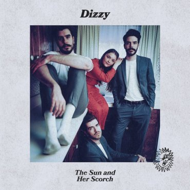 Photo of the band members of Dizzy sitting on a kitchen counter.