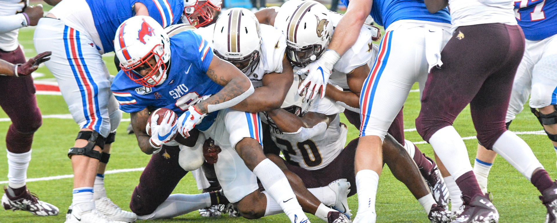 Reggie Robinson Jr. fights for extra yards against the Texas State Bobcats defense.