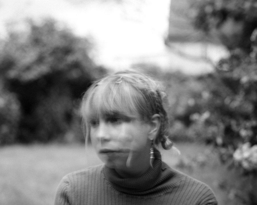 Black and white blurred picture of Lili Trifilio
