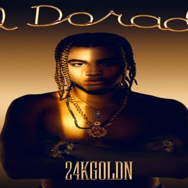 """The album cover for El Dorado by 24kGoldn shows 24kGoldn standing with his arms crossed in gold and black light with """"El Dorado"""" written in cursive above him"""