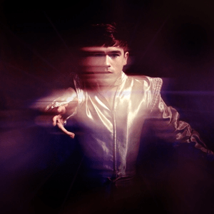 The album cover is a photo of Declan McKenna captured while he is spinning in a sparkly, retro-looking suit.