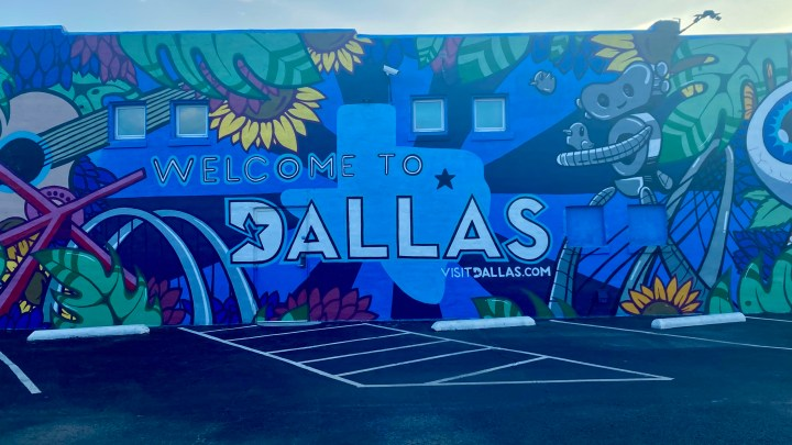 """painting of an assortment of iconic Dallas landmarks with the words """"Welcome to Dallas"""" in the center"""