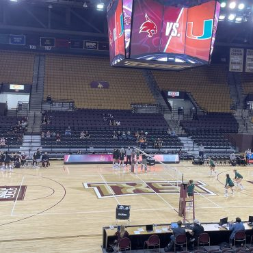 On September 10, both Miami and Texas State volleyball prepare to take the court before their matchup in the Bobcat Invitational. The stands are empty as people begin to filter into the arena.