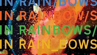 The photo is a rainbow explosion with rainbows text colors of the album name, In Rainbows