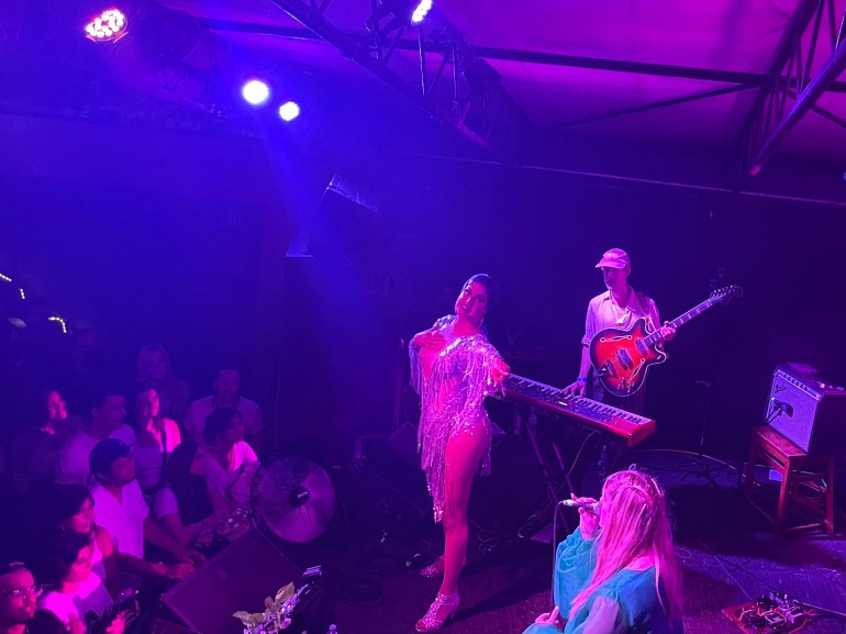 """Molly Burch (lower right) and Cynthia Lee Fontaine (center) performing Molly Burch's """"Take A Minute"""" onstage at the Mohawk in Austin, Texas."""
