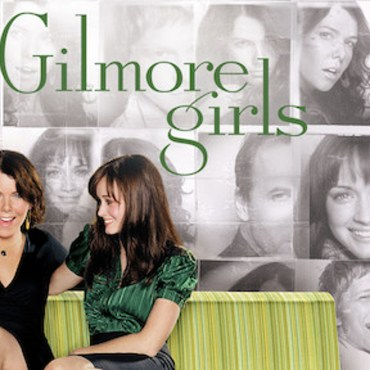 """Netflix's Gilmore Girls cover. Black and white background with multiple character faces behind the green words """"Gilmore Girls"""" and a green couch where Lorelai and Rory Gilmore are sitting."""
