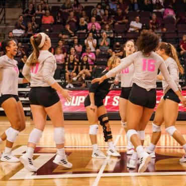 After the Bobcats won a point against ULM, six players gather to celebrate the point. (Jada Gardner, Brooke Johnson, Emily DeWalt, Caitlan Buettner, Tessa Marshall, Janell Fitzgerald)
