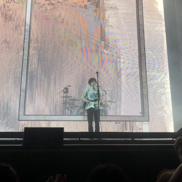 The 1975 playing live with a static background projected.