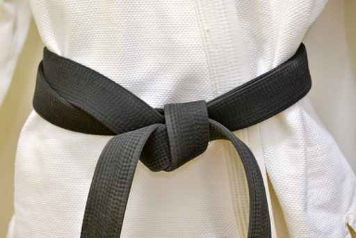 Karate Black Belt on White Uniform