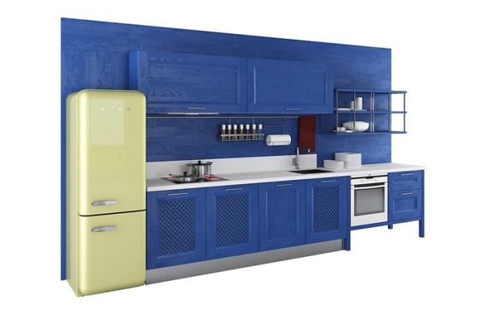 Салатовый холодильник на кухне синего цвета
