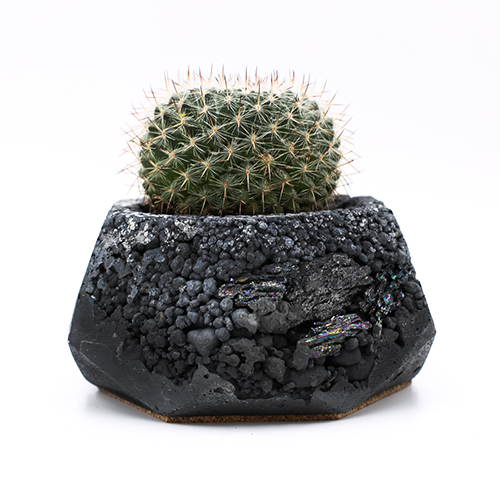 Planter Pot Amsterdam Heiligeweg, black color with mineral stones. Octogonal shape handmade in Berlin by Kula.