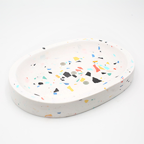 Soapdish Cannes Av de Grasse, white and terrazzo color, oval shape with three draining holes, handmade in Berlin by Kula.