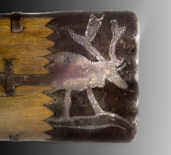 Figuren av en ren instansad på ett metallbleck