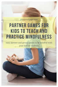 Kumarah yoga partner games for kids to teach and practice mindfulness, easy partner and group games to be mindful with your kids or students. a young girls sits and meditates back to back with an adult
