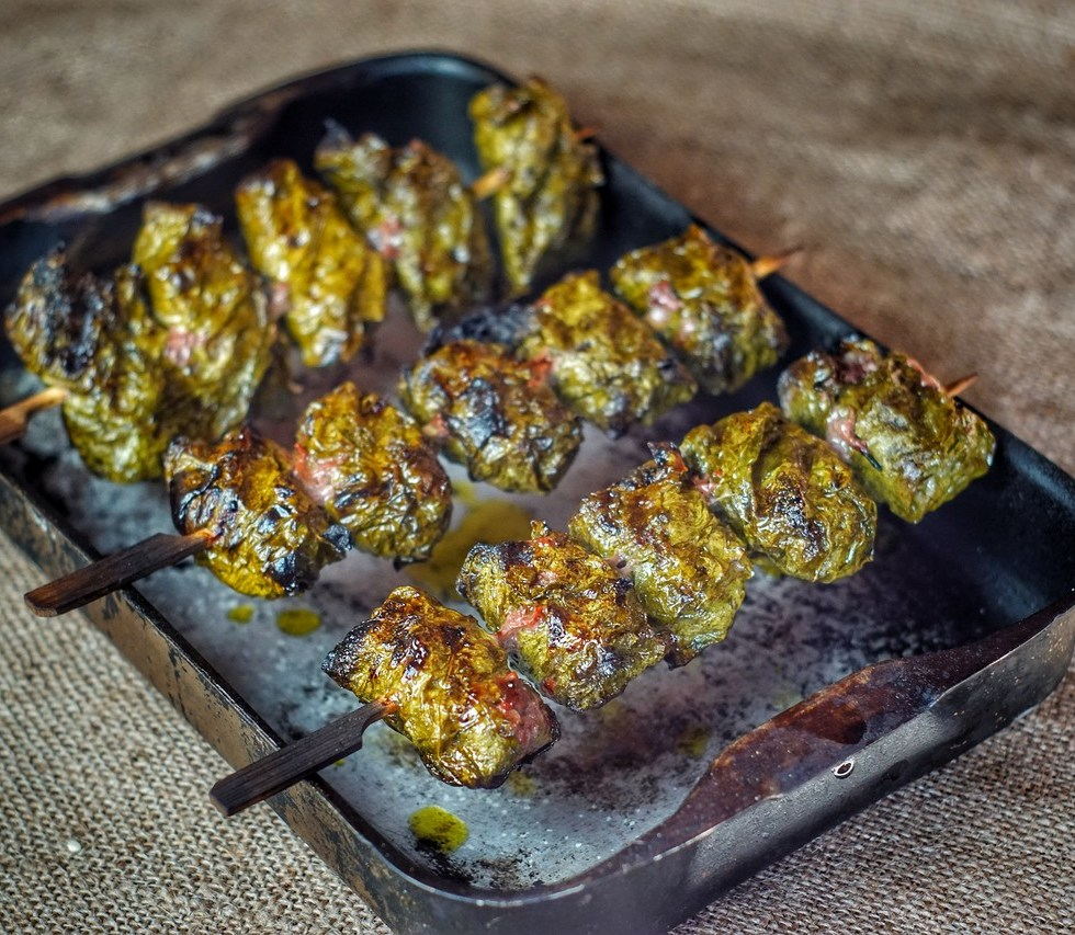 Beef wrapped in vine leaves