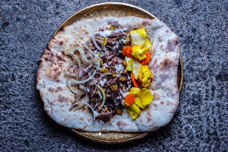 Pulled Shawarma Spiced Lamb with Toum (garlic sauce), Tahina Sauce, House Pickles, Sumac Onions and Yemenite Dynamite (S'chug)