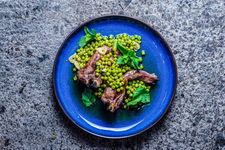 Charcoal grilled lamb chops with fresh peas and a hot cumin and mint vinaigrette
