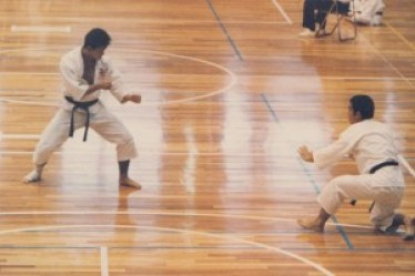 Kenya becoming a 3rd-degree black belt in Shorinji Kempo in his teens...