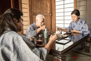 Master Gotetsu, young Gouken and Sayaka at dinner