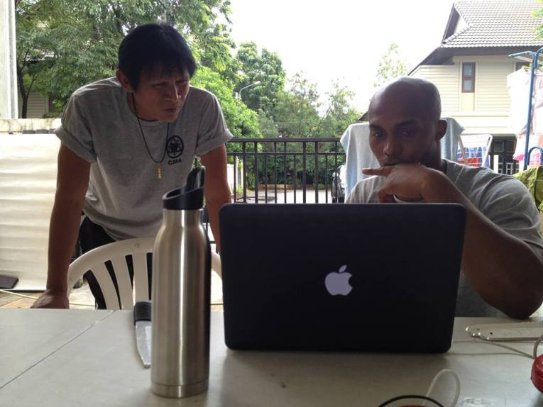 Panna and Marrese reviewing footage