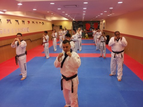 TKD practitioners line up for the day's training