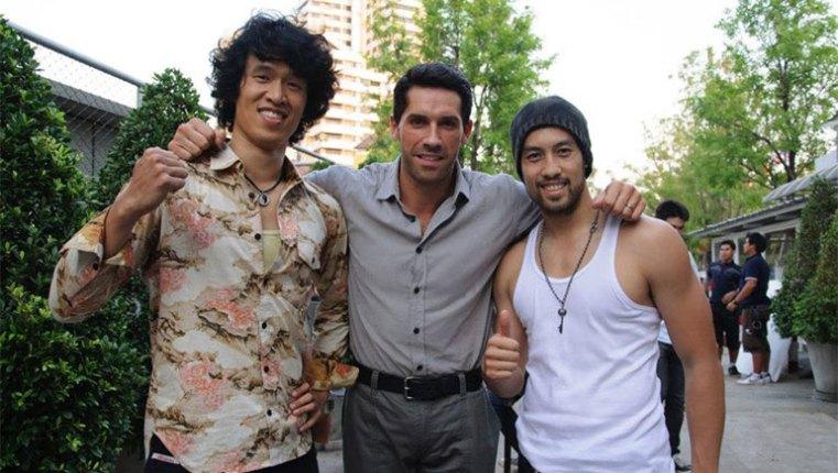 Kazu Patrick Tang (R) with Scott Adkins and Charlie Ruedpokanon (L)