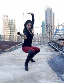 Jenny strikes a pose on the set of Lady Bloodfight