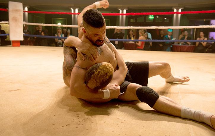 Pinning his callous foe to the mat