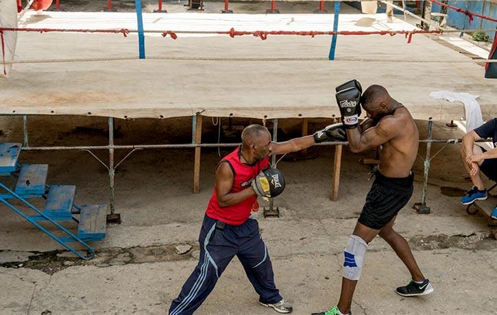 Idris Elba and coach Nardo Flores spar at the Rafael Trejo boxing gym in Old Havana