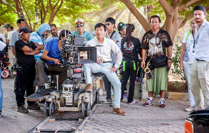 Jackie with crew on set of Kung Fu Yoga