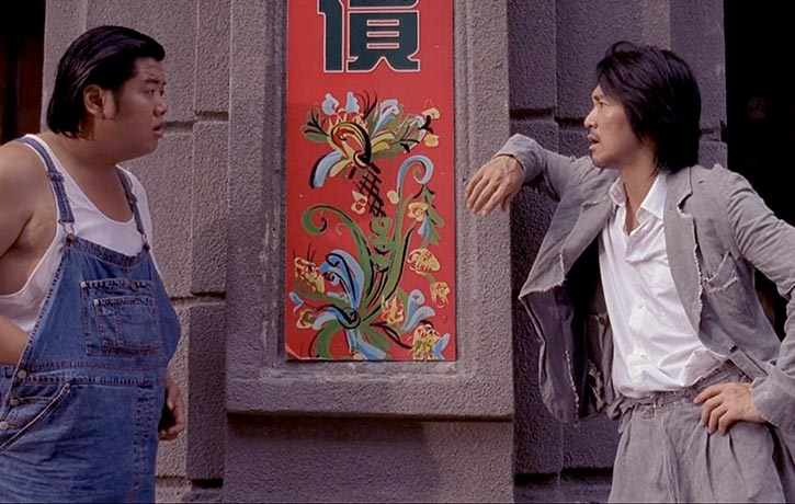 Lam Chi-Chung as Bone and Stephen Chow as Sing