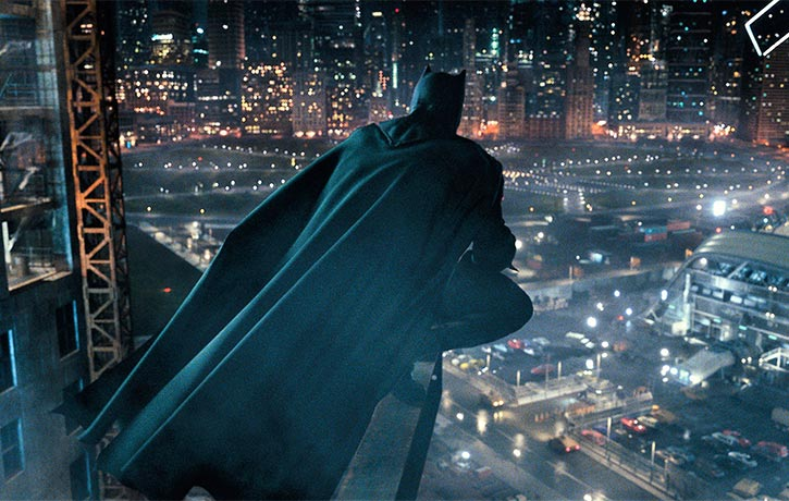 Batman broods over the city skyline