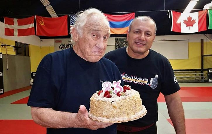Gokor celebrates with his mentor Gene LeBell