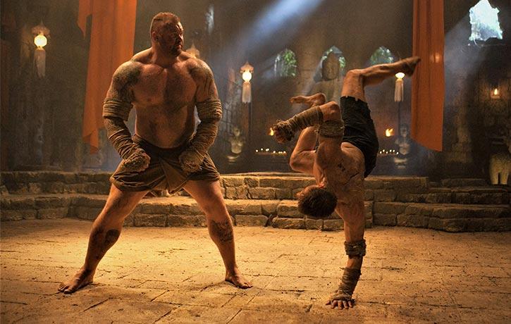 Kurt delivers a capoeira-like move
