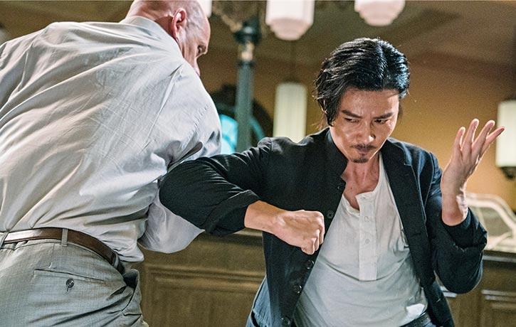 Cheung lands an elbow strike on Owen