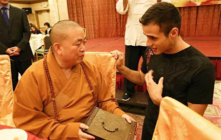 Philip speaking to the Shaolin Temple abbot, Shi Yongxin