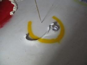 Yvette Schiffers [Ding hangend aan een geel touw]