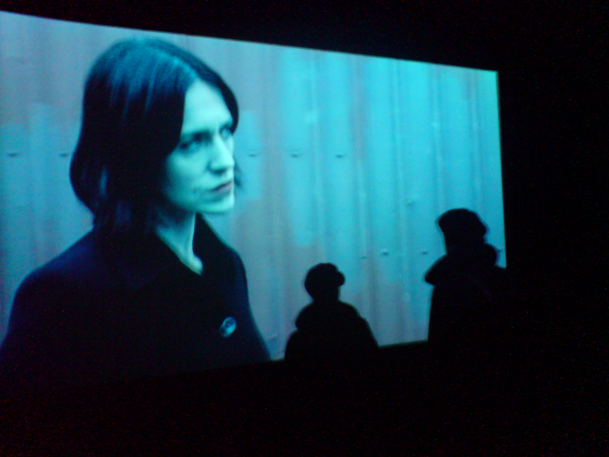 me doubled in front of a video by willie doherty, Foto by Antonio Guidi